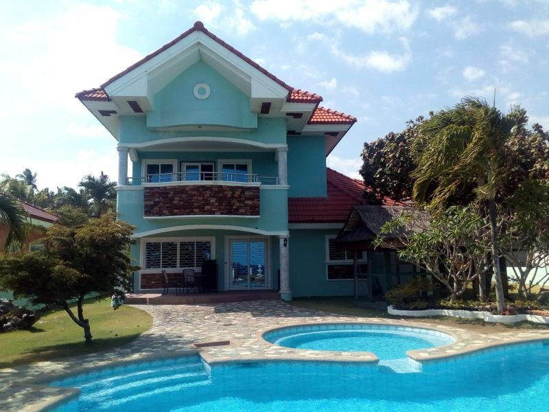beachfront house with swimming pool, great view of apo island