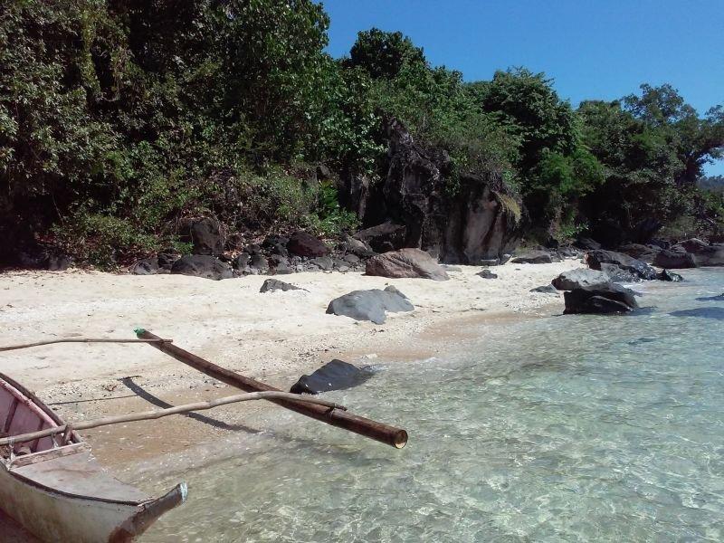 white sand beach front in island- retirement tourist home