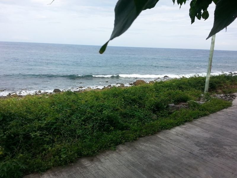 beach front and adjacent to road - 3 hectares of land